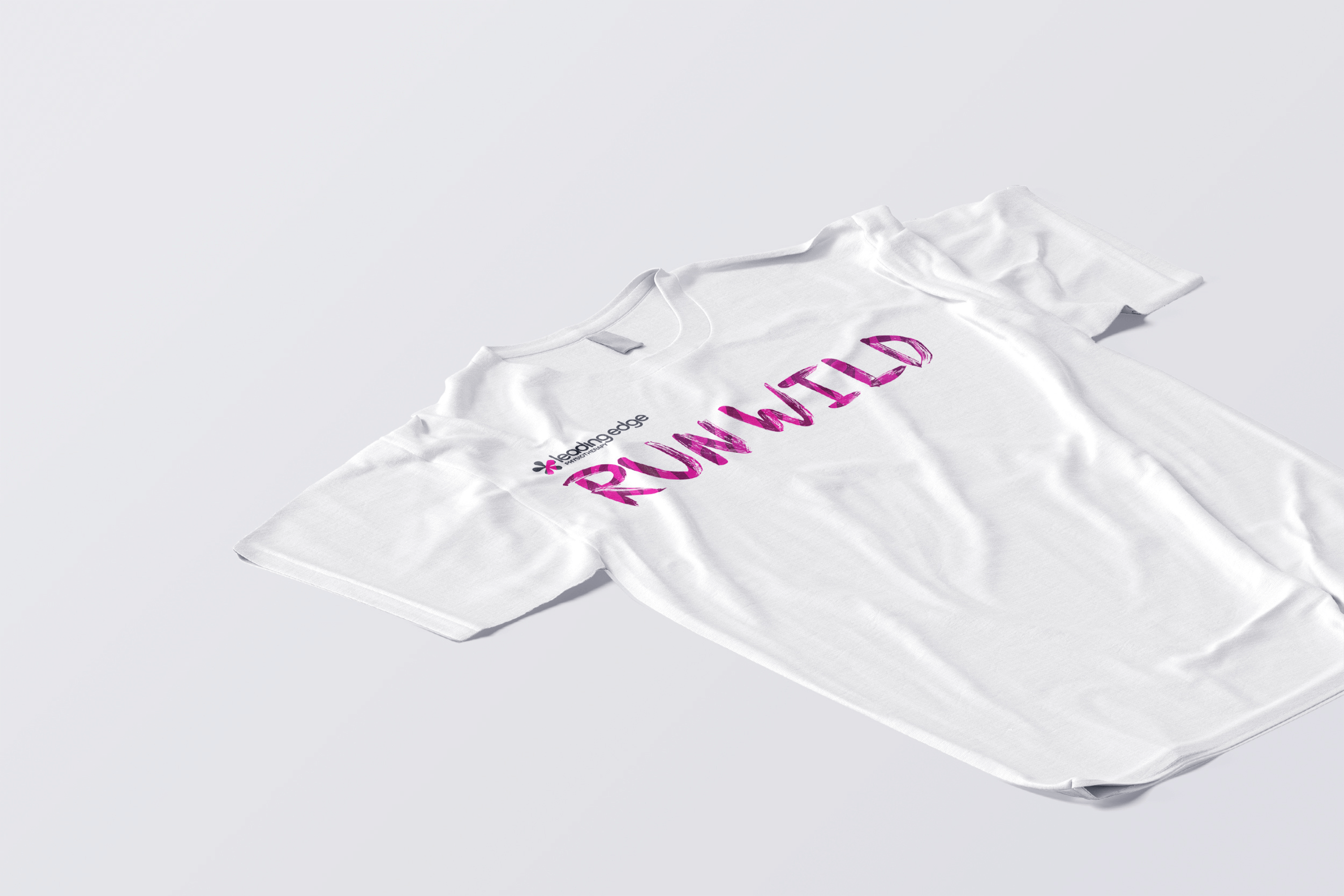 A white t-shirt with the the stylized Run Wild logo on it